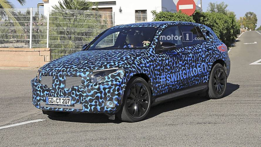 Mercedes EQ C swaps usual camo for funky wrap in new spy shots