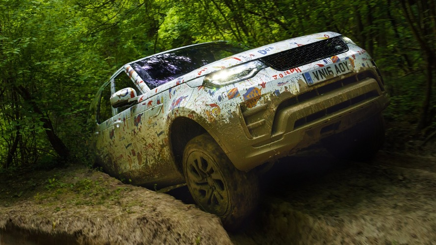 2017 Land Rover Discovery camouflaged with kids' drawings